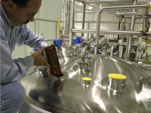 Quality technician doing Positive Material Identification on a stainless-steel vessel using an X-ray fluorescence gun. Courtesy of Holland Applied Technologies