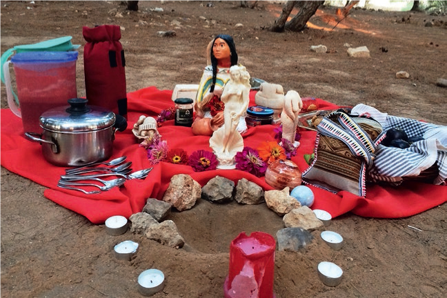 Moon blood ceremony altar (August 2015). Hollow at bottom of image for receiving women's gifts of menstrual blood. Photograph