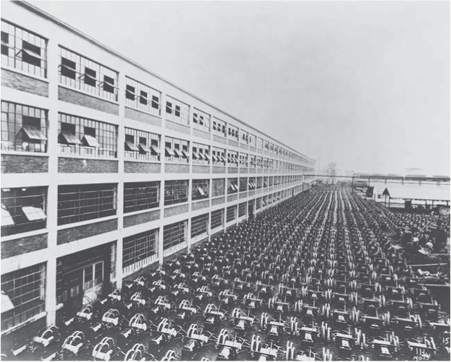 One thousand Ford Model T chassis, one shift's output, outside the Highland Park Plant, 1913. The collections of The Henry Ford (P.O. 716/ THF109225)