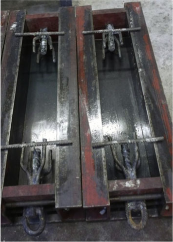 Modified steel moulds showing anchors [8]