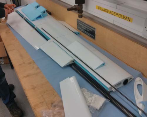SPOTTER UAV wing under construction showing the two-part aileron plus flap, all hinged off a common rear wing spar - note also the nylon torque peg on the rib nearest the camera