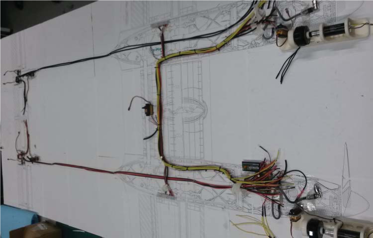 "SPOTTER ""iron bird"" test harness layout. Note the full-size airframe drawing placed under the wiring"